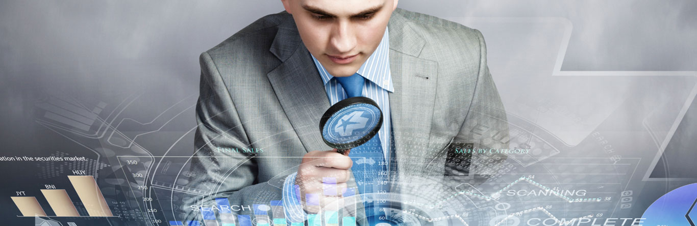 man using magnifying glass on computer screen